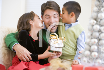 Royalty Free Photo of a Father Getting a Gift From His Children
