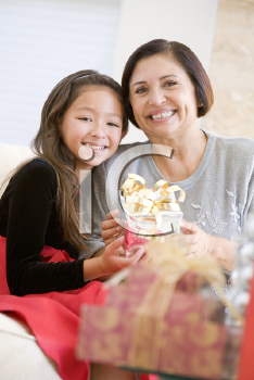 Royalty Free Photo of a Grandmother and Granddaughter With a Christmas Gift
