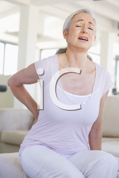 Royalty Free Photo of a Woman With Back Pain