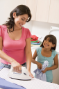 Royalty Free Photo of a Mother and Daughter Ironing