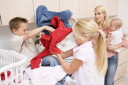 Royalty Free Photo of Children Fighting While Doing Laundry