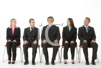 Royalty Free Photo of a Group of People in Chairs