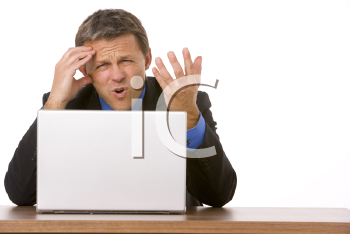Royalty Free Photo of an Angry Man at a Laptop