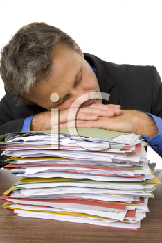 Royalty Free Photo of a Man Overwhelmed by Paperwork