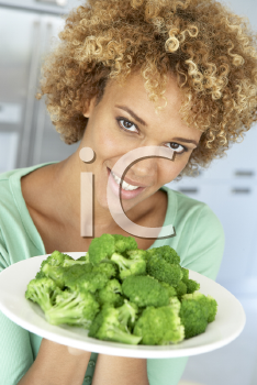 Royalty Free Photo of a Woman With a Plate of Broccoli