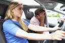 Royalty Free Photo of a Girl Taking a Driving Lesson