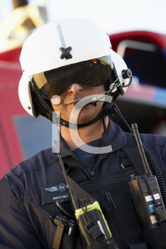 Royalty Free Photo of a Paramedic in Front of an Air Ambulance
