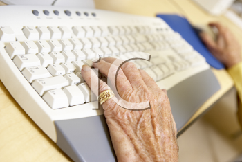 Royalty Free Photo of a Person's Hand on a Keyboard