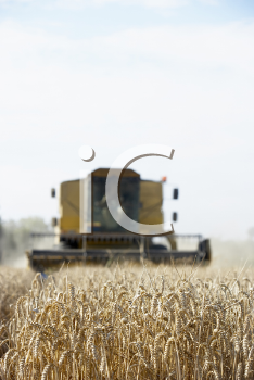 Royalty Free Photo of a Combine in a Field