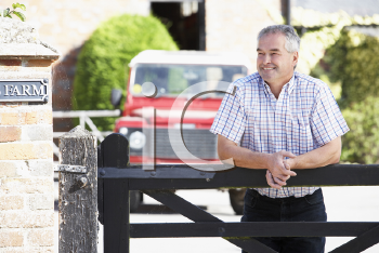 Royalty Free Photo of a Man at a Farm Gate