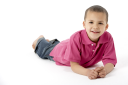 Royalty Free Photo of a Little Boy on His Stomach