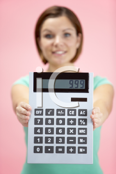 Royalty Free Photo of a Woman Holding a Calculator