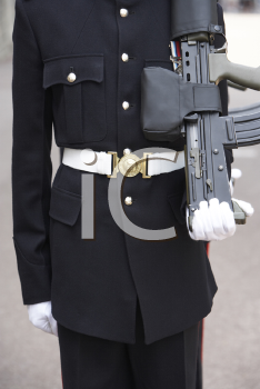 Royalty Free Photo of a Soldier With a Gun