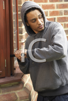Royalty Free Photo of a Guy Breaking Into a House