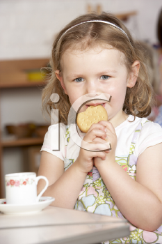 Royalty Free Photo of a Little Girl Having Tea in Preschool