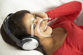 Royalty Free Photo of a Young Woman Listening to Music