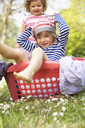 Young Boy Sitting In Laundry Basket