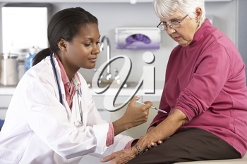 Doctor Giving Senior Female Patient Injection