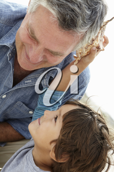 Young boy and grandfather with seashell