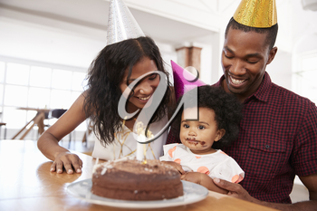 Parents Celebrating Birthday With Young Daughter At Home