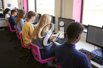 Line Of Teenage High School Students Studying In Computer Class