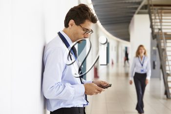 Portrait of young male doctor with stethoscope and smartphone