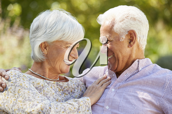 Happy senior couple in garden embracing, head and shoulders
