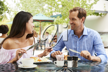 Portrait Of Couple Enjoying Meal At Outdoor Caf� Together