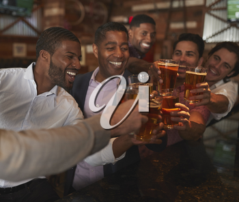 Group Of Male Friends On Night Out For Bachelor Party In Bar Making Toast Together