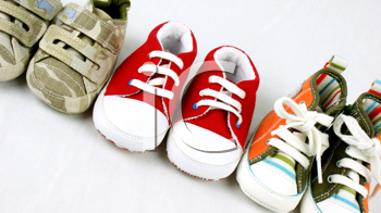 Line up of baby shoes