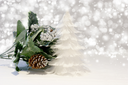 Christmas tree of feathers and greenery on silver starry background