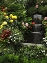 Magnificent cascade fountain in well-known Butchard -garden on island Vancouver