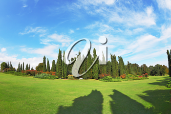 The most romantic landscape park garden in Italy.  The shadows of the cypresses slender gently fall on the green meadows