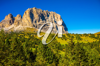 The famous picturesque Sella Pass in the Dolomites. Windy sunny autumn day. Travel to South Tyrol. The concept of extreme and ecological tourism