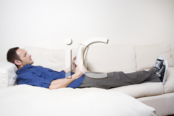 Royalty Free Photo of a Man Relaxing With a Book