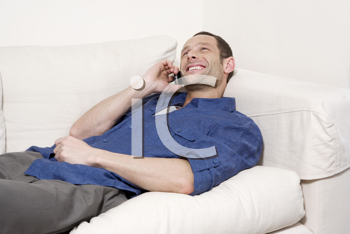 Royalty Free Photo of a Man at Home Talking on His Cell