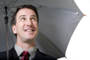 Royalty Free Photo of a Man Under an Umbrella