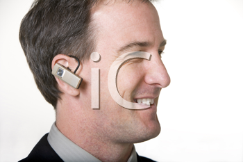 Royalty Free Photo of a Man With a Listening Device