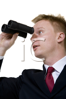 Royalty Free Photo of a Man in a Suit Looking Through Binoculars