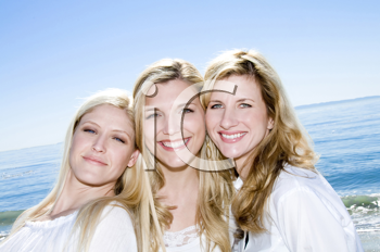 Royalty Free Photo of Three Women Smiling on the Beach