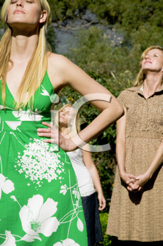 Royalty Free Photo of Three Women Standing in the Sun