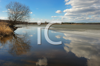 Royalty Free Photo of the Spring Thaw on Water With Reflected Clouds