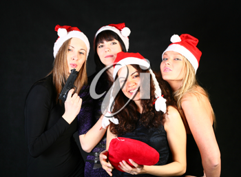 four 20-25 years  women  friends having fun on a christmas party