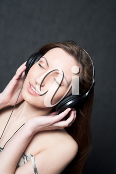 woman with headphones listening to music closed eyes