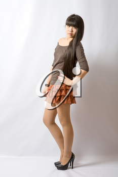 Young asian student. Beautiful young woman. Portrait of asian woman in brown skirt