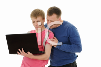 Royalty Free Photo of a Father and Son Holding a Laptop