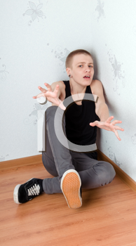 Royalty Free Photo of a Teenager Sitting in a Corner