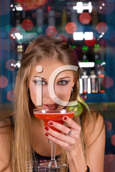 Royalty Free Photo of a Woman Holding a Cocktail in a Club