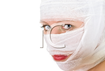 Royalty Free Photo of a Woman With Bandages on Her Face