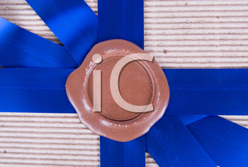 Royalty Free Photo of a Wax Seal on a Gift Box